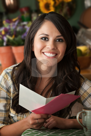 Beautiful Latina Woman with Greeting Card stock photo, Beautiful Latina Woman at Table in Kitchen Greeting Card by Scott Griessel