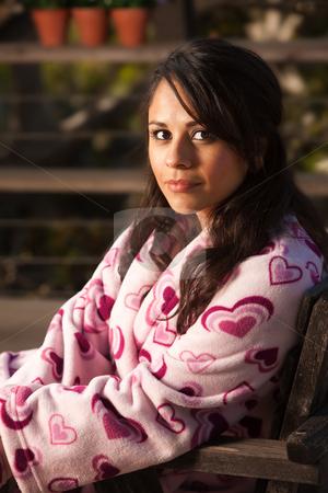 Pretty Hispanic Woman in Bathrobe stock photo, Pretty Hispanic Woman in Bathrobe Sitting Outdoors by Scott Griessel