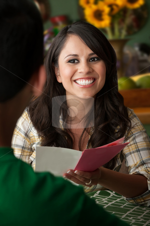 Beautiful Latina Woman with Birthday Card stock photo, Beautiful Latina Woman at Table in Kitchen Birthday Card by Scott Griessel