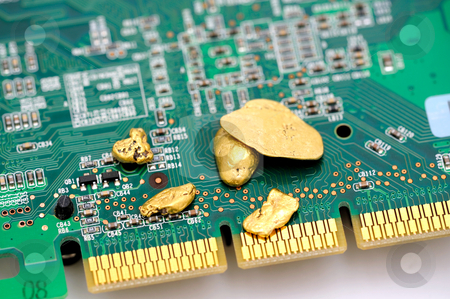 Gold And Circuitry stock photo, Gold is an important part of modern technology. raw gold nuggets on top of a finished circuit board  with gold plated connections by Lynn Bendickson