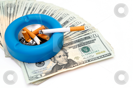 Cigarettes - Money Up In Smoke stock photo, Concept of the waste of money that is spent for the cigarette smoker or the cash that could be saved by Lynn Bendickson