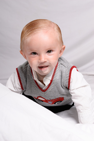 Handsome Toddler stock photo, A child portrait of ahandsome toddler dressed in nice clothing and is crawling and smiling at the viewer by Richard Nelson
