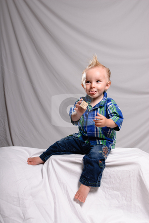 Funny Expression Portrait stock photo, A young boy making a funny face while getting his portrait done by Richard Nelson
