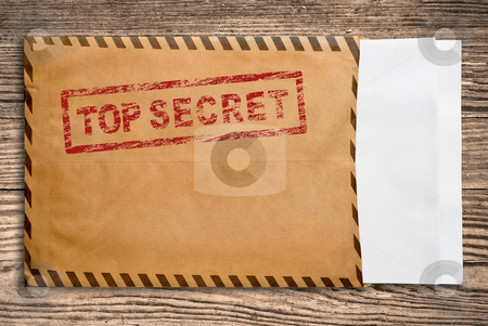 Envelope with top secret stamp and blank papers. stock photo, Open yellow envelope with top secret stamp and blank papers, on wooden table, clipping path. by Pablo Caridad