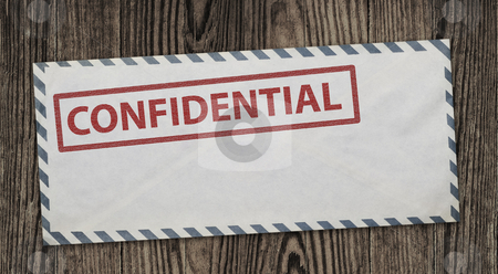 Confidential envelope. stock photo, Confidential  envelope on wooden background, clipping path. by Pablo Caridad