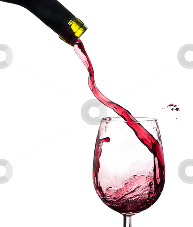 Wine splash on a glass, white background. stock photo, Red wine splash on a glass, white background. by Pablo Caridad
