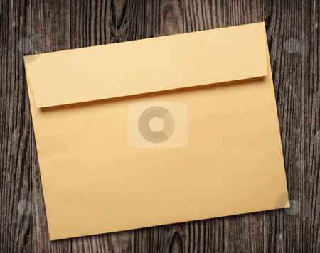 Golden envelope on wooden table. stock photo, Golden envelope on wooden background, clipping path, studio shot. by Pablo Caridad