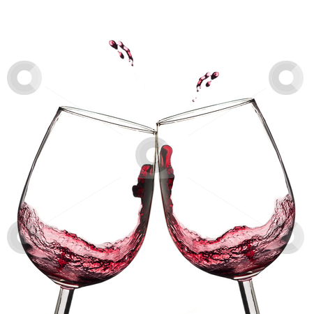 Wine toast. stock photo, Two wine glasses in toasting  with splash. by Pablo Caridad