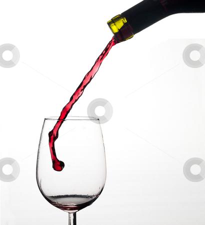 Wine splash on glass. stock photo, Wine splash on a glass, white background. by Pablo Caridad