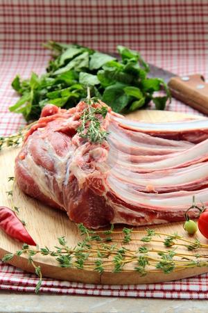 Lamb meat cut into steaks  stock photo, Lamb meat cut into steaks on wooden board by Olga Kriger