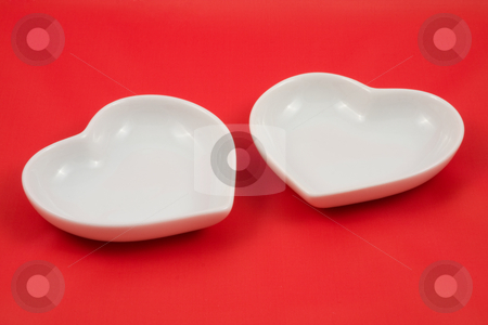 Two Hearts stock photo, Two Hearts isolated over red background with copyspace by Jo De Vulder