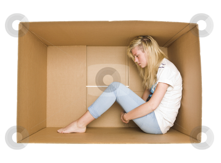 Woman in a cardboard box stock photo, Woman siting in a cardboard box isolated on white background by Anne-Louise Quarfoth