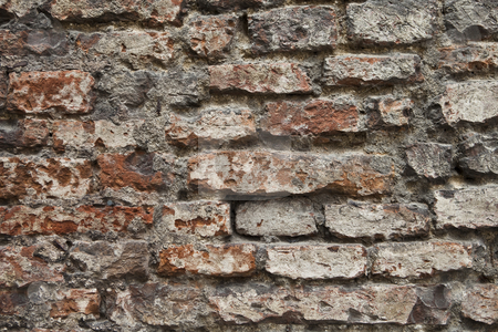 Brick wall stock photo, Worn, almost broken brick wall by Anne-Louise Quarfoth