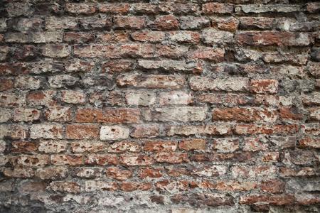 Brick wall stock photo, Worn brick wall by Anne-Louise Quarfoth