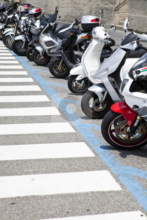 Parked motorcycles stock photo, Row of parked motorcycles by Anne-Louise Quarfoth