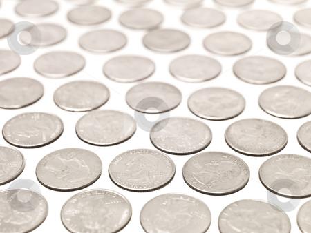 Quarter Coins stock photo, Arranged Quarter coins on white background by Anne-Louise Quarfoth