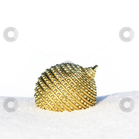 Christmas card stock photo, Golden christmas bauble in snow by Viktor Thaut