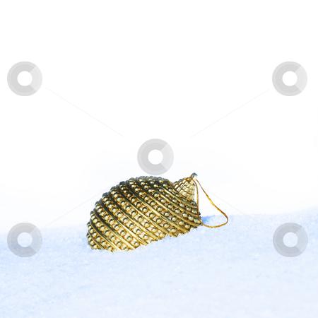 Christmas bauble scene stock photo, Golden christmas bauble in snow by Viktor Thaut