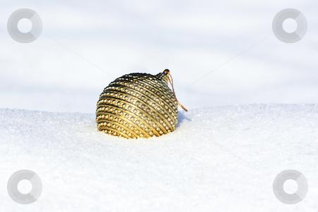 Christmas ball in snow stock photo, Christmas ball in snow by Viktor Thaut