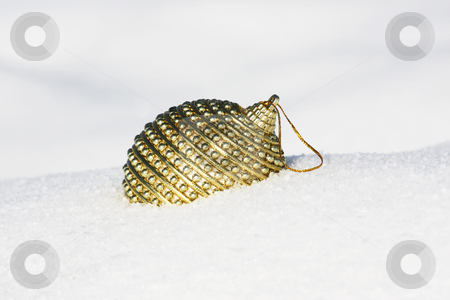 Christmas bauble in snow stock photo, Christmas bauble in snow by Viktor Thaut