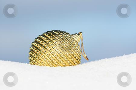 Golden bauble stock photo, Christmas ball in snow by Viktor Thaut