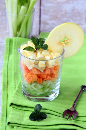 Salad of celery and apple and carrot  stock photo, Salad of celery and apple and carrot in a glass lined coats by Olga Kriger