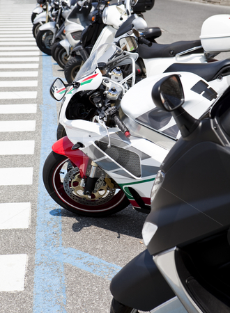 Row of motorbikes stock photo, Row of parked motorbikes by Anne-Louise Quarfoth