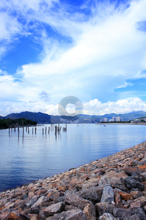 Blue lake idill under cloudline sky  stock photo, Blue lake idill under cloudline sky. by Keng po Leung