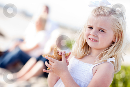 Adorable Little Blonde Girl with Starfish stock photo, Adorable Little Blonde Girl with Starfish at The Beach. by Andy Dean
