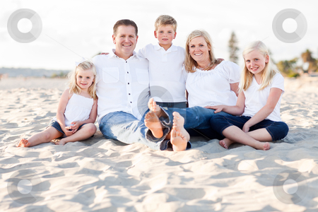 Happy Caucasian Family Portrait at the Beach stock photo, Happy Caucasian Family Portrait at the Beach One Sunny Afternoon. by Andy Dean