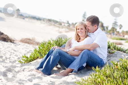 Attractive Caucasian Couple Relaxing at the Beach stock photo, Attractive Caucasian Couple Relaxing and Enjoying the Beach Together. by Andy Dean