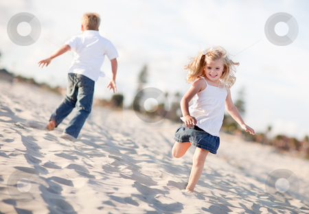 Adorable Brother and Sister Having Fun at the Beach stock photo, Adorable Brother and Sister Having Fun at the Beach One Sunny Afternoon. by Andy Dean