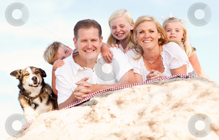 Happy Caucasian Family and Dog Portrait at the Beach stock photo, Happy Caucasian Family and Dog Portrait at the Beach One Sunny Afternoon. by Andy Dean