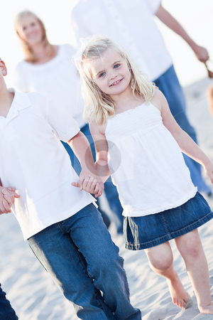Adorable Little Girl Walking With Her Family stock photo, Adorable Little Girl Walking With Her Family at the Beach. by Andy Dean