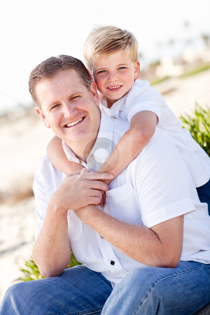 Cute Son with His Handsome Dad Portrait stock photo, Cute Son with His Handsome Dad Portrait at the Beach by Andy Dean
