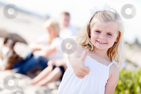 Adorable Little Blonde Girl with Thumbs Up At the Beach stock photo, Adorable Little Blonde Girl with Thumbs Up At the Beach with Her Family. by Andy Dean
