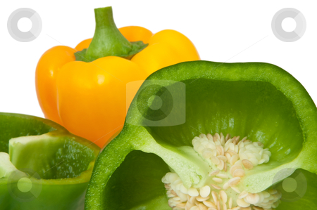 Bell peppers. stock photo, Close up capturing whole and halved bell peppers arranged over white. by Samantha Craddock