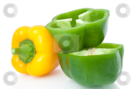Bell peppers. stock photo, Close up capturing a small selection of whole and halved bell peppers arranged over white. by Samantha Craddock