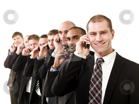 Business men on the phone stock photo, Group of business men on the phone isolated on white background by Anne-Louise Quarfoth