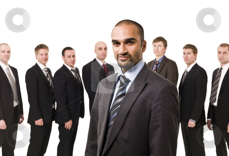 Boss in front of his team stock photo, Business Manager in front of his team isolated on white background by Anne-Louise Quarfoth