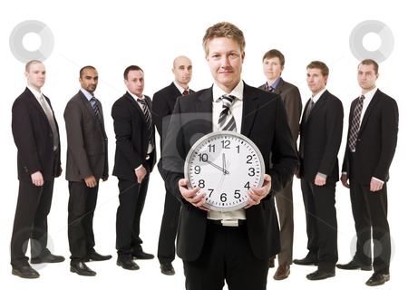 Business Manager with a clock stock photo, Business Manager with a clock in front of his team by Anne-Louise Quarfoth