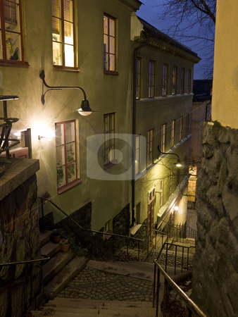 Alley with stairs at night stock photo, Alley with stairs at night in a city by Anne-Louise Quarfoth