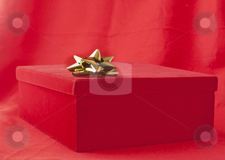 Gift stock photo, Red box containing a gift over red background by Fabio Alcini
