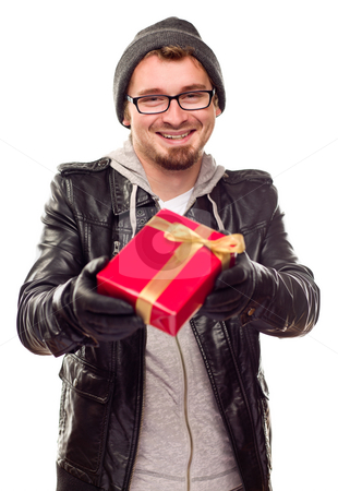 Warmly Dressed Young Man Handing Wrapped Gift Out stock photo, Warmly Dressed Handsome Young Man Handing Wrapped Gift Out Isolated on a White Background. by Andy Dean