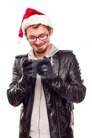 Young Man with Santa Hat Using Cell Phone stock photo, Smiling Young Man with Santa Hat Using Cell Phone Isolated on a White Background. by Andy Dean