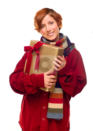 Pretty Red Haired Girl with Scarf Holding Wrapped Gift stock photo, Pretty Red Haired Girl with Scarf Holding Wrapped Gift Isolated on a White Background. by Andy Dean