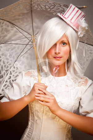 Pretty White Haired Woman with Parasol and Classic Dress stock photo, Pretty White Haired Woman Wearing Classic Dress with Parasol and Small Top Hat. by Andy Dean