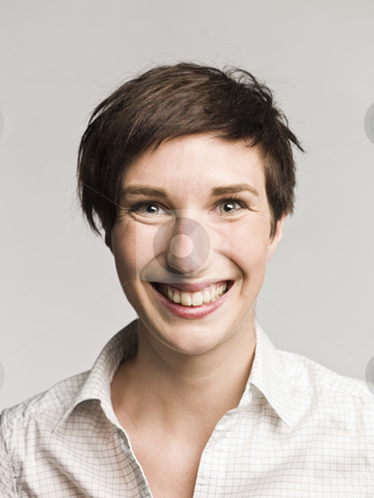 Portrait of a laughing woman stock photo, Portrait of a laughing woman by Anne-Louise Quarfoth