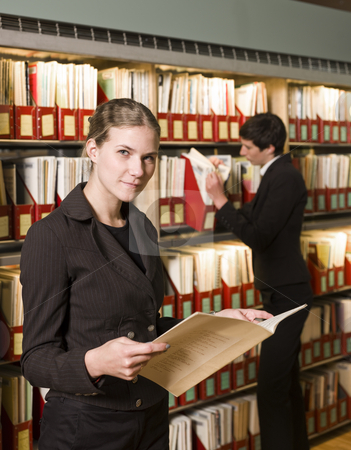 Two women at a library stock photo, Two women at a library by Anne-Louise Quarfoth