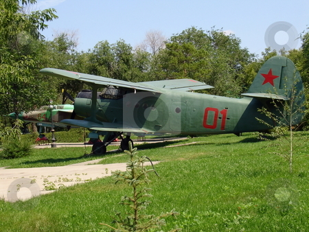 Biplane stock photo, Colored military airplane at the outdoor museum by Vladislav Chekanin